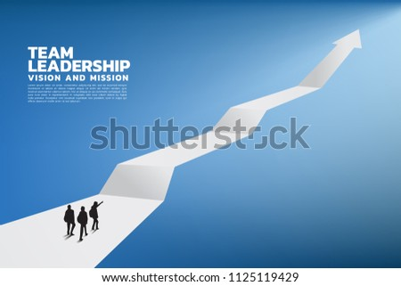 Silhouette of a team leader look up to business growing arrow, Concept of teamwork, leadership, Goal, Mission and Vision,