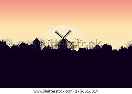 silhouette of a village with a mill. Dawn of the sun. Vector Stock photo ©