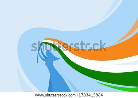 Silhouette of a woman hoisting the Indian tricolour flag . An Indian Independence Day concept