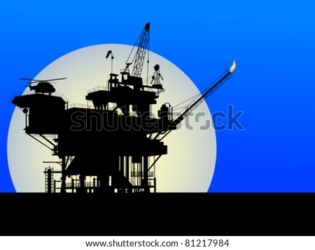Silhouette of an oil platform in the moon light