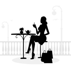 Silhouette of beautiful woman in cafe