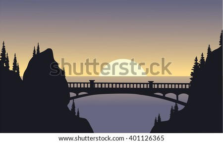 silhouette of bridge and moon