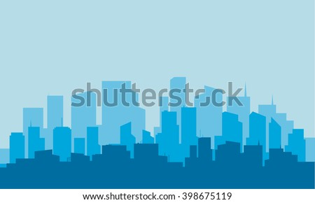 Silhouette of building with blue background at night