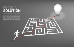 Silhouette of businessman running with route path to exit the maze to light bulb. Business concept for problem solving and finding idea.