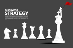 Silhouette of businessman with red flag on chess piece king. Business Concept of strategy planning and success