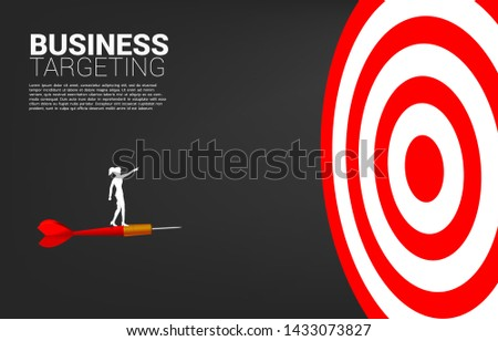 01cb3854f24 silhouette of businesswoman standing on arrow dart point forward to  dartboard. Business Concept of targeting