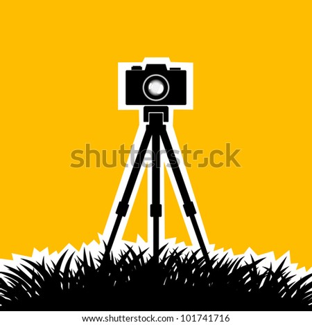 Silhouette of camera on orange background