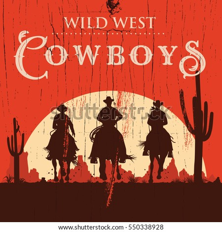 silhouette of cowboys riding