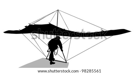 Silhouette of hang glider waiting to take off
