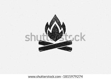 Silhouette of hot campfire burning on logs on campsite hand drawn stamp effect vector illustration. Vintage grunge texture on old paper for poster or label decoration.