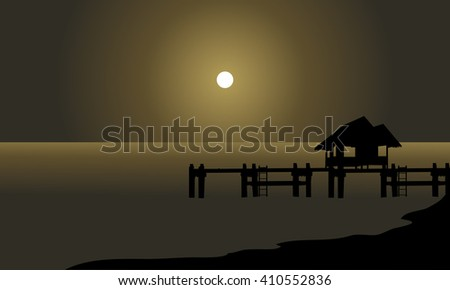 silhouette of hut and pier at