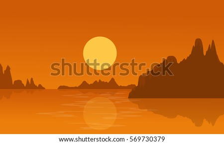 silhouette of lake and cliff