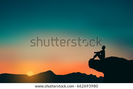 silhouette of man sitting on