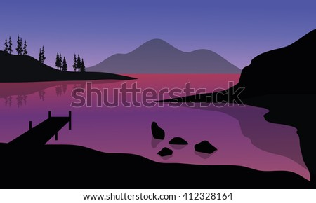 silhouette of pier and mountain