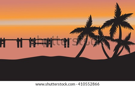 silhouette of pier in sea with
