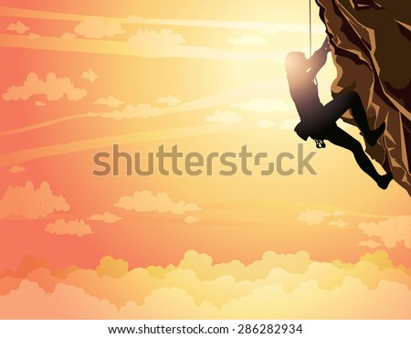 silhouette of rock climber on a