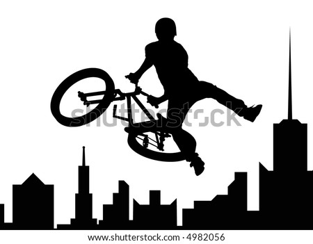 Silhouette of the bicyclist executing a stunt