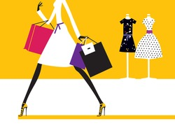 Silhouette of the fashion woman holding the bags walking in the shopping store mall.
