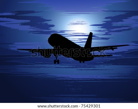 Silhouette of the plane against the evening sky with clouds