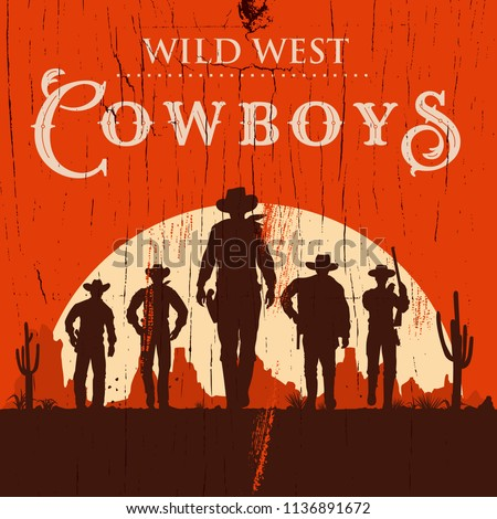 silhouette of three cowboys