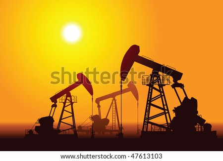 Silhouette of three oil rigs