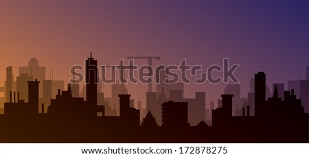 silhouette of town with sunset