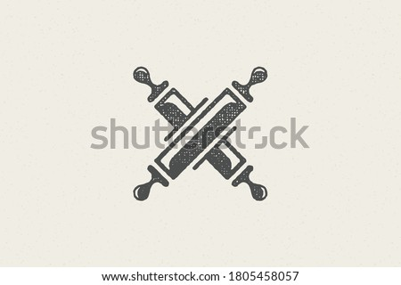 Silhouette of traditional rolling pins crossed as symbol of pastry preparation hand drawn stamp effect vector illustration. Vintage grunge texture for packaging and menu design or label decoration.