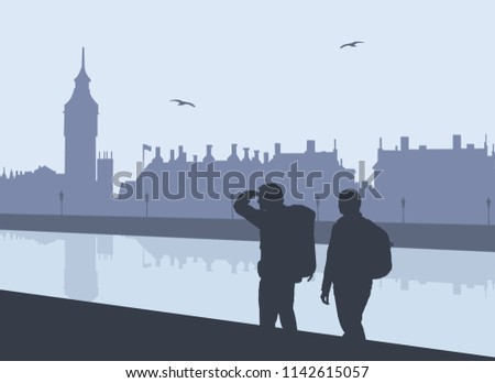 silhouette of two tourists with