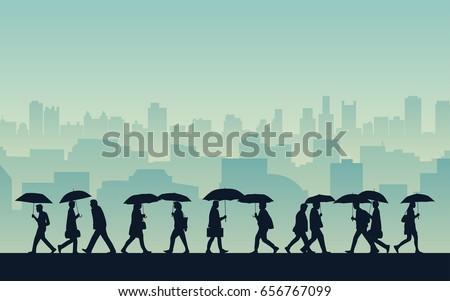silhouette people walking in...