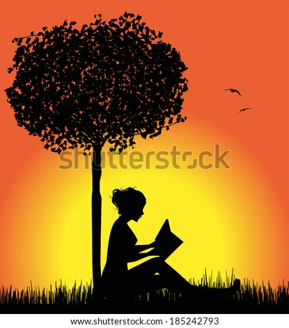 silhouette reading a book at