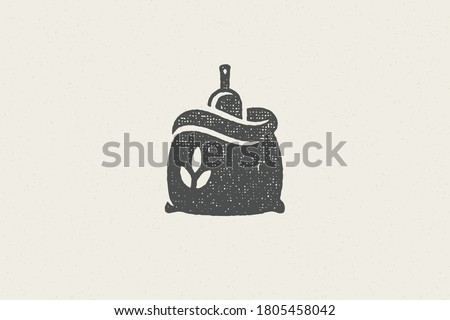 Silhouette sack of wheat flour with scoop designed for grain farming industry hand drawn stamp effect vector illustration. Grunge texture for packaging design or label decoration. Stock photo ©