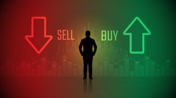 silhouette trader standing looking at stock market chart with buy and sell symbol