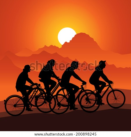 silhouettes bike riders in
