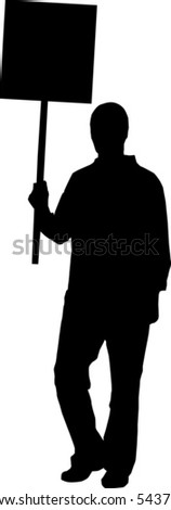 Silhouettes of a person holding a sign