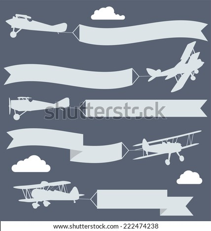 silhouettes of biplanes with