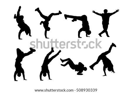silhouettes of breakdancers