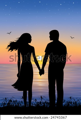 Holding Hands In Sunset. standing and holding hands