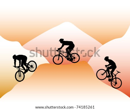 silhouettes of mountain bikers