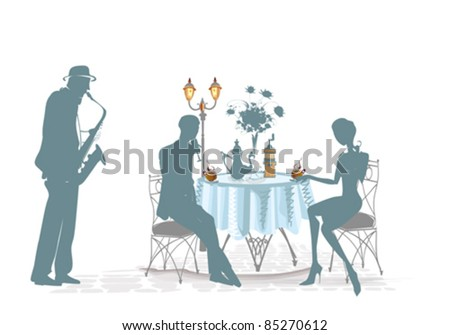 Silhouettes of people in cafe with a musician