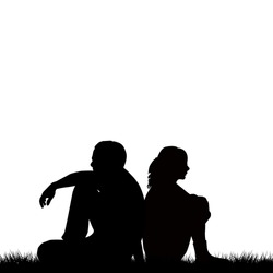 Silhouettes of sad couple sitting back to back