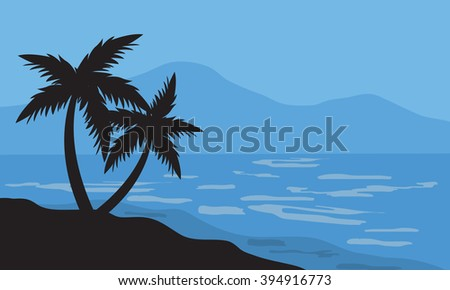Silhouettes of two palm in beach