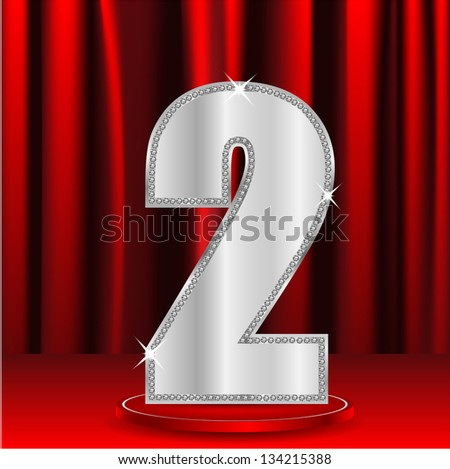 silver number two decorated by brilliant stones on a background a red curtain