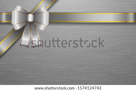 silver ribbon and silver bow on the silver plate