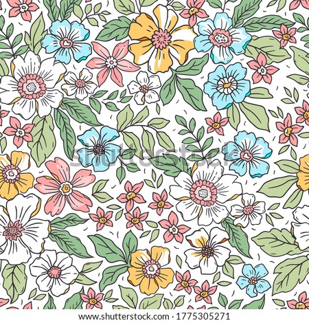 Simple cute pattern in small colorful flowers on white background. Liberty style. Ditsy print. Floral seamless background. The elegant the template for fashion prints.