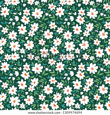 Simple cute pattern in small white and  flowers on dark green background. Liberty style. Ditsy print. Floral seamless background. The elegant the template for fashion prints.