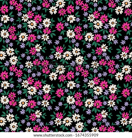 Simple cute pattern in small white and purple flowers on black background. Liberty style. Ditsy print. Floral seamless background. The elegant the template for fashion prints.