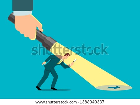 Simple flat business vector illustration of a businessman being guided by a hand holding a flashlight uncovering arrow sign.