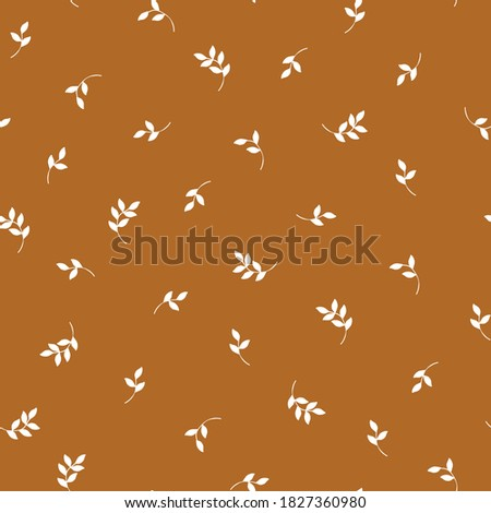 Simple vintage pattern. Small white plants leaves. Brown background. Vector texture. Fashionable print for Wallpaper. ストックフォト ©