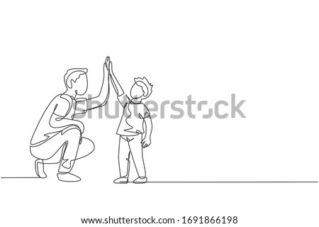 Single continuous line drawing of young dad giving high five gesture to son for success school achievement, parenthood time. Family parenting concept. Trendy one line draw design vector illustration
