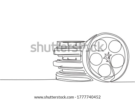 Single continuous line drawing stack of retro old classic cinema video film reels. Vintage movie frame filmstrip item concept one line draw design vector illustration graphic